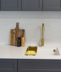 Wood and brass tones can add warmth to a crisp grey and white colour scheme.
