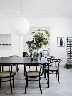This open dining space with original moulding and herringbone floors is sure to make every meal feel five star. | Interior Inspiration for the New Year | Musings on Momentum