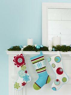A simple mantel arrangement complements whimsical Christmas stockings. More mantel ideas: