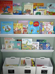 Organized children's books using rain gutters and bins. Great for changing up books each season.