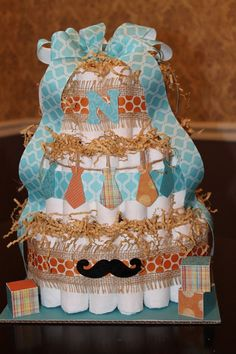 Diaper cake-wide grosgrain pastel ribbon instead of the burlap, change the mustaches to bow ties on bottom layer, neckties on the second layer and mustaches on the top layer, with some sort of name pennant on top.  I love the clothes pins as clips.