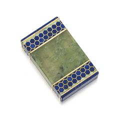 Nephrite, lapis lazuli, turquoise and diamond cigarette case, Cartier, 1929. The nephrite body inlaid with two bands of gold, lapis lazuli and turquoise decorated in a honeycomb pattern, the short sides set with lapis lazuli plaques, one integrated with the hinged cover, the thumbpiece set with rose diamonds, the interior engraved 'Linda 14.7.29.'
