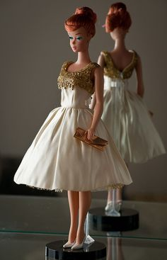 Titan Swirl Barbie, 1964 (Vintage Repro) by bridgetfleming, via Flickr bridgetfleming She is wearing J'Adore L'Or by Dressmaker Details.