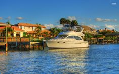 Small yacht harbored by the mansions wallpaper