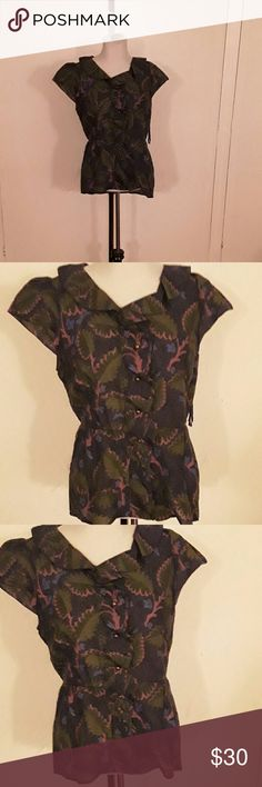 Anthropologie leaf print peplum top This is a gorgeous top by Vanessa/Virginia from anthropologie.  Brass button detailing. Ruffle collar, peplum bottom. Cap sleeves. Size 12, bust is 34-36. No stretch. Anthropologie Tops Button Down Shirts