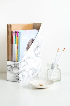 Stationery storage doesn't need to be boring and/or expensive. You can make these marbled magazine holders from cereal boxes in minutes!