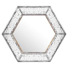 Featuring a hexagonal silhouette and mercury glass-style frame, this shimmering mirror adds glamorous appeal to your entryway or living room.