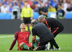 Cristiano Ronaldo Photos - Cristiano Ronaldo of Portugal receives medical treatment during the UEFA EURO 2016 Final match between Portugal and France at Stade de France on July 10, 2016 in Paris, France. - Portugal v France - Final: UEFA Euro 2016