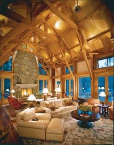 Exposed beams and a two-story fireplace are rustic elements that have made country houses comfortable for centuries
