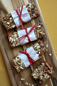 Mmm...I want to try these! Homemade Granola Bars. (Recipe Girl - http://www.recipegirl.com/2012/04/18/homemade-granola-bars-and-the-pure-kitchen-cookbook-giveaway/)