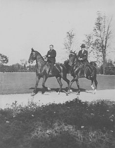 F.A. Siberling (owner and builder of stan hywet hall) cantering with his neighbor and rival Harvey S. Firestone on the Stan hywet grounds.
