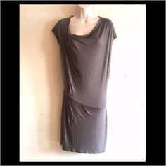 NWOT Helmet Lang Silk Dress Dark grey taupe, asymmetrical slimming design in hem and waist, gathered neckline. Partially lined. Very soft. I found some small spots on front very hard to see and can't detect on camera. May be taken off by Dry cleaner. 30% silk, 70% viscose. Size P. No trades. Generous discounts with bundle. Helmut Lang Dresses Midi