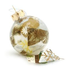Decoupaged inside!  I used gold, silver and green print tissue paper, glue and long tweezers inside a round clear glass ornament. They are for sale through my Etsy shop.  #etsy #christmas #homedecor #holiday #christmasballs #handmade #homemade