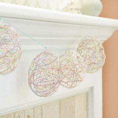 Turn pastel emboridery floss into festive egg garland! Find out how here: http://www.bhg.com/holidays/easter/crafts/easter-crafts-for-all-ages/?socsrc=bhgpin022313embroideryeggs=6