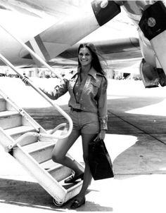 Air Florida Flight Attendant poses in front of Lockheed L-188 Electra at Miami Airprot - 1973 .Air Florida was based at Miami International Airport. It was formed in 1971 and started operations in 1972. . Services extended to Europe, the Northeast, and Latin America before the airline shutdown in 1984.