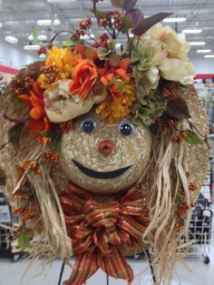 Don't want a wreath? Take a straw hat and make her up!!!