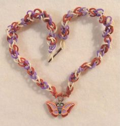 One of my Rainbow Loom creations, a necklace in the diamond pattern with a fimo butterfly charm.