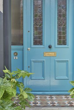A teal front door can make your neighbours green with envy. Impress your visitors and create a perfect first impression with our front door paint ideas. Garage Door Colors, Front Door Colors, Front Door Decor, Garage Doors, Front Door Accessories, Modern House Colors, Bright Front Doors, Painted Front Doors, Door Furniture