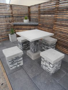 Concrete Outdoor Furniture - Cube Concrete Design Gabion stools with concrete tops.