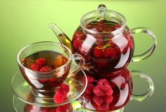 Picture of Black fruit raspberry tea in glass teapot and cup on green background stock photo, images and stock photography. Glass Tea Cups, Glass Teapot, Raspberry Leaf Tea, Yellow Fruit, Teapots And Cups, Frozen Treats, High Tea, Healthy Drinks, Chocolate Fondue