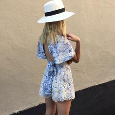 As worn instore: Gabby at Zimmermann LA Store wears Confetti Wrap Top and Confetti Scallop Flare Short.
