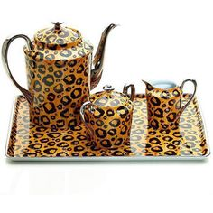 Leopard print coffee and tea set.
