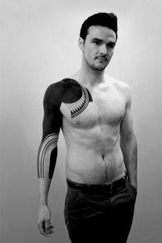 Full black arm tattoo