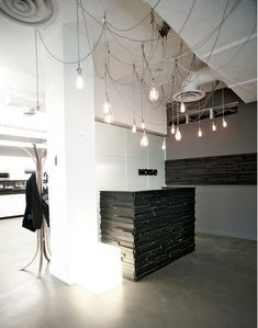reception desk - really simple w/ irregular wood similar to Distillery District wall - just an idea.....this could fit into an urban clinic.