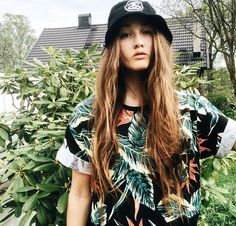 Tropic Injection tee from SWEET SKTBS and Stüssy bucket worn by Elsa Maria Nilsson.