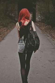 Red hair and black outfit: