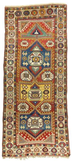 A Gendje Kazak long rug, Central Caucasus - illegibly dated upper right hand corner, approximately 316 by 140cm; 10ft. 4.5in., 4ft. 7in., third quarter 19th century