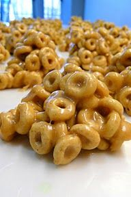 Cheerio Treats  Only 5 ingredients:1 c. sugar, 1 c. corn syrup, 1 c. creamy peanut butter, 1 t. vanilla, 5 c. Honey Nut Cheerios    In a large sauce pan, combine sugar and corn syrup. Bring to boil over medium heat.Allow mixture to boil for one minute and remove from heat.Add peanut butter and vanilla to mixture and mix until smooth.Add Cheerios and mix until all coated. Drop mixture by spoonful onto waxed paper and allow to cool. Makes approximately 2 dozen.