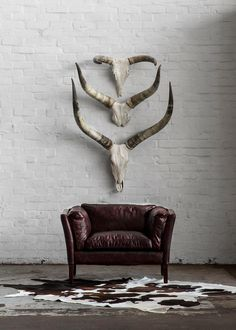 The retro-styled design of the Reggio is reminiscent of the clean, streamlined forms of the early century – a time when simplicity was championed and excessive ornamentation was minimised. The leather is 'hand-aged' to give it a distressed look. Decor, Weylandts, Minimalist Living Room, House Design, Luxury Furniture, Interior Design, Taxidermy Decor, African Decor, Minimalist Home Decor