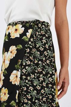 Feel summer vibes all year round in this pretty midi skirt. Featuring contrast floral print and a wrap tie for a flattering fit. Team with a plain tank top and black sandals for an easy-to-wear outfit. #Topshop