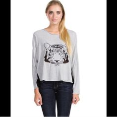 NWT Kitty Tee Feel fierce but calm with this relaxed embroidered tiger long sleeve shirt. Featuring mesh on underside of sleeves. Pair with some boyfriend denim and a good time! Available in XS, S, M, L. Boutique Tops Tees - Long Sleeve