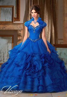 Elegant and unforgettable, turn heads by wearing Mori Lee Vizcaya Quinceanera Dress Style 89105 at your Sweet 15 party. Made out of satin and organza, this Quince dress features a strapless satin bodi