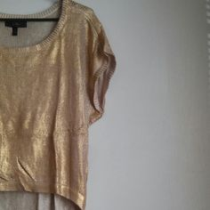 Jessica Simpson golden blouse Golden shimmery blouse. Good condition. A bit wrinkly and a minor stain at the front. Beautiful color for under the moon parties. Jessica Simpson Tops Blouses