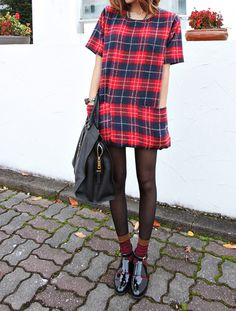 plaid t shirt dress. black sheer tights. patent black short boots. mid calf socks. bag.