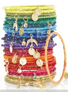 Make a whole arm party of DIY rainbow, ribbon-wrapped bracelets with this step-by-step video tutorial!