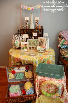 Love this table and suitcase displays