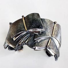 "Parole, Parole by David Bigazzi  ""Cuff in sterling silver, 18k gold and white diamonds. Fits approximately a size 6 wrist. 1 1/2"" wide. Exhibit: Louder than Words"""