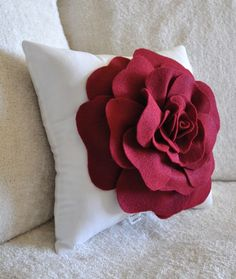 Ruby red rose pillow by Bedbuggs Boutique.