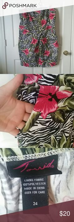 Floral print torrid dress This is a very flattering dress. It has pockets and is strapless. There is a zipper up the back. Looks great paired with a black cardigan and heels. ?I do offer a 10% discount off 2 or more items from my closet. Come take a look!? torrid Dresses