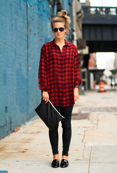 Plaid shirt and a messy top knot.