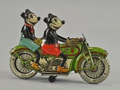 Mickey and Minnie Mouse on 1932 tin motorcycle toy, from the German 'Tippco' company. Estimated value: $23,000-28,000.