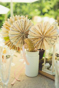 paper pinwheels, photo by Sarah Kathleen http://ruffledblog.com/woodsy-wedding-with-paper-bouquets #weddingideas #diy