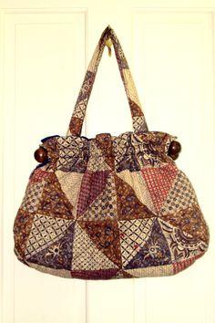 quilted bag - granny - fabric bag - hobo bag - tote bag - satchel - knitting bag - patchwork - wood - brown - natural - Anthropologie style. $26.00, via Etsy.