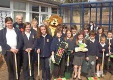 Wisbech Lions Club present new garden tools to the Leverington Academy after the school's original tools were stolen.