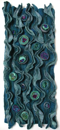 Manipulated felt gives a textured work in relief.