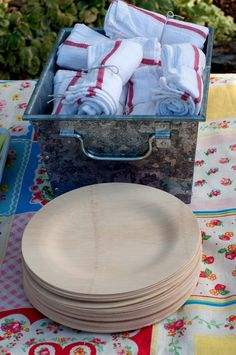 bamboo plates and wash cloth napkins tied with twine